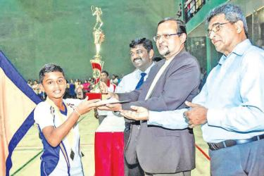 Boys 'A division champions Rahula College, Matara skipper receiving the champion trophy from SLBA Vice President Parakrama Basnayake
