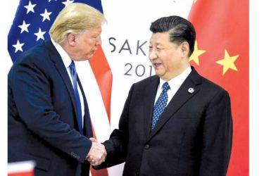 US President Donald Trump, with China's President Xi Jinping, announced he will sign a partial US-China trade deal in January 2020 Photo: AFP