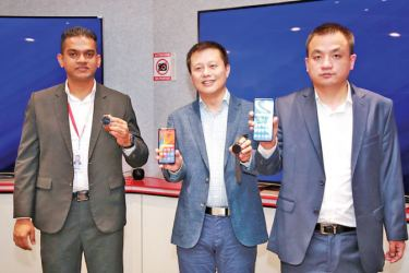 Huawei Consumer Business Group Sri Lanka, Head of Marketing- Charitha Karunarathne, Head of Products- David Xukai, Country Head-Peter Liuyi. Picture by Sudath Malaweera