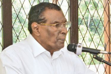 Economic and Policy Development State Minister W.D.J. Seneviratne speaking at the meeting.