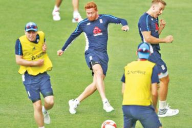 England cricketers play a game of football as a warm-up before a day's play.