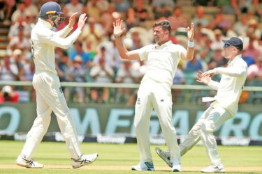 England's James Anderson celebrates a wicket.