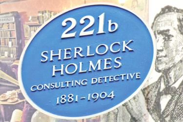 Blue plaque at Sherlock Holmes Museum on Baker Street, London.