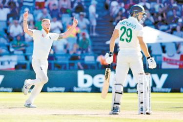 England's Ben Stokes (L) celebrates after the dismissal of South Africa's Dwaine Pretorius (R) during the fifth day of the second Test cricket match between South Africa and England at the Newlands stadium in Cape Town on January 7, 2020. AFP