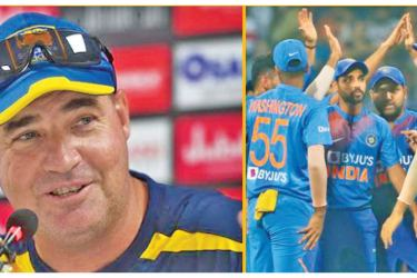 Sri Lanka coach Mickey Arthur (left) and India celebrate another Sri Lanka wicket.