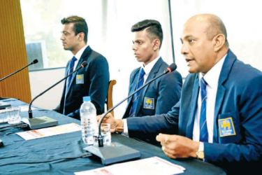 Sri Lanka under 19 coach Hashan Tillakaratne (extreme right) addresses the media in the presence of manager Farveez Maharoof and captain Nipun Dhananjaya.
