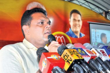 State Minister Shehan Semasinghe addresses the gathering. Picture by Amila Prabath Wanasinghe