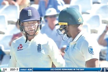 Jos Buttler (left) got involved in a heated debate with South Africa's Vernon Philander (right).