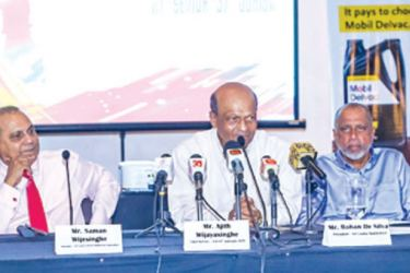 The Chief Referee – SLB 67th Nationals Ajith Wijayasinghe addressing the gathering during the media briefing held at 80's Club on Wednesday. The Secretary of Sri Lanka Schools Badminton Association (SLSBA) Saman Wijesinghe (left) and President of Sri Lanka Badminton (SLB) Rohan de Silva (right) are also seen here. Picture by Ranjith Asanka
