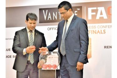 The President of Football Federation of Sri Lanka (FFSL) Anura de Silva (right) and Secretary of FFSL Jaswar Umar (left) selecting teams at a draw held at Football House on Wednesday. Picture by Herbert Perera