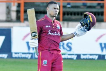West Indies opener Evin Lewis celebrates his century in his team's five-wicket win over Ireland in the third ODI played at Grenada on Sunday.