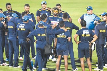 Sri Lanka's cricketers take part in a practice session ahead of the three-match series against India at Assam Cricket Association Stadium in Guwahati. - AFP