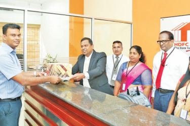 Chief Executive Officer Palitha Gamage accepts the first deposit from a customer