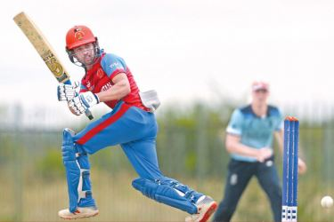 Afghanistan's Farhan Zakhail hits the ball towards the boundary during the ICC Under 19 Cricket World Cup warm-up match against England at Mandela Cricket Oval on Tuesday.