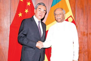 Foreign Minister Dinesh Gunawardena with Chinese Foreign Minister and State Councillor Wang Yi.