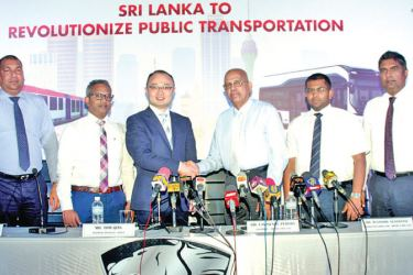 Dr. Lawrence Perera, with the officials of Higer Bus Company Korea and  Mirco Car in Colombo Picture by Saliya Rupasinghe