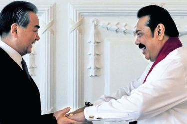 Chinese State Councilor and Foreign Minister Wang Yi with Sri Lankan Prime Minister Mahinda Rajapaksa.
