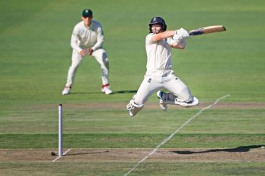 England's Ollie Pope uppercuts for four during an unbroken 76-run fifth-wicket partnership with Ben Stokes during the first day of the third Test cricket match against South Africa on Thursday. - AFP