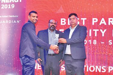 A representative from Millennium I.T.E.S.P receives the award for Best Partner – Gold
