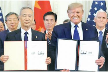 US President Donald Trump, right, signed the first phase of a trade deal with Chinese Vice Premier Liu He, left, on Wednesday in Washington, DC [Evan Vucci/AP Photo]