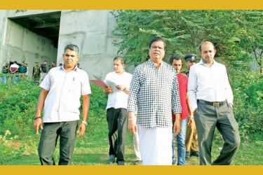 INSPECTION: Information and Communication Technology and Higher Education, Technology and Innovation Minister Dr. Bandula Gunawardena inspecting the building complex. MPs Namal Rajapaksa and D.V. Chanaka were present.