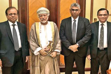 Minister Susil Premajayantha and Parliamentarian Faiszer Musthapha with Oman's Foreign Affairs Minister Yusuf bin Alawi bin Abdullah, in Muscat.