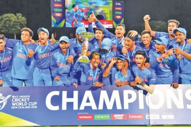 India's team poses to celebrate its victory in the 2018 Under-19 cricket World Cup final against Australia at Bay Oval in Mount Maunganui.