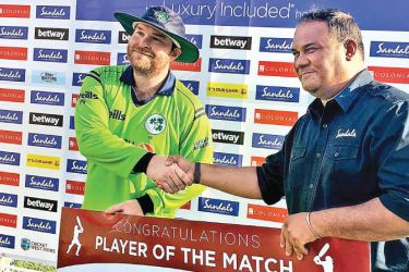 Ireland's Paul Stirling receives the Player of the Match award after his match-winning knock of 95 against West Indies in the first T20I at Grenada.