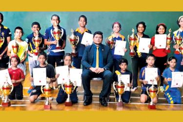 Winners with their trophies are seen here with Chief Guest Secretary of the Table Tennis Association Chandana Srinath Wijethunga.