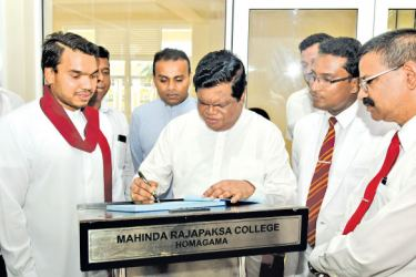 NEW BUILDING COMPLEX: The opening of the new administration building complex  at Mahinda Rajapaksa College, Homagama  took place under the patronage of  Higher Education, Technology and Innovation   Minister Dr Bandula Gunawardena  yesterday.  This three storied building complex   also houses a fully equipped library.  Parliamentarian Namal Rajapaksa  and Education Ministry Secrtary  N.H.M.Chitrananda were present