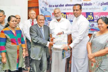 ANCL Chairman President's Counsel W Dayaratne handing over the first copy of Oruwella to Fisheries and Aquatic Resources Development Minister Douglas Devananda and State Minister Sanath Nishantha, while Ministry Secretary Indu Rathnayaka, ANCL General Manager Abhaya Amaradasa,  Managing Editor Government Relations Samantha Karunarsekara, and Editor of the publication Buddhika Imbulana look on. Picture by Wasitha Patabendige and Kelum Liyanage