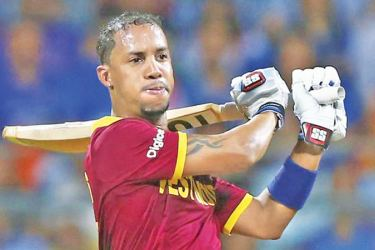 West Indies batsman Lendl Simmons blasted 10 sixes as Windies routed Ireland to draw the three-match T20I series.