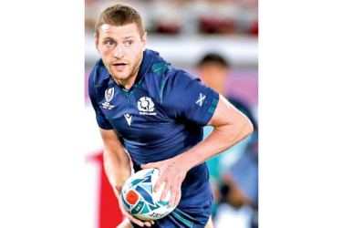 Scotland fly-half Finn Russell will miss the Six Nations opener after a breach of team protocol. - AFP