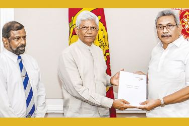 President Gotabaya Rajapaksa receives the 'Study on Managing Foreign Policy and Relations with the UN System' from Pathfinder Foundation Chairman Bernard Goonetilleke.