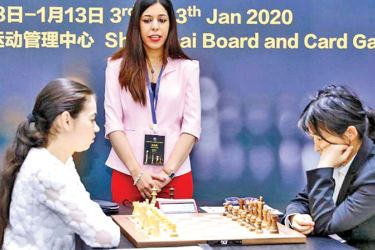 Iranian chess referee Shohreh Bayat is scared to return home after a photo was taken of her during a tournament.