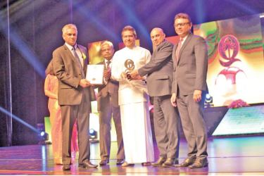Chief Executive Officer Manoj Pathiraja receives the National Quality Award for the year 2019