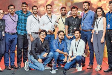 99X Technology's Most Outstanding Project Team for 2019 with their award at the company's annual kickoff, held at the Kingsbury, Colombo