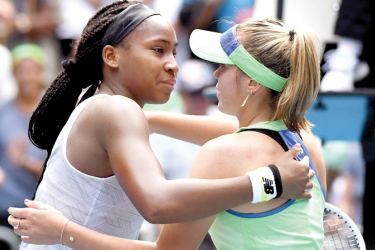 Sofia Kenin of the US gives a hug to Coco Gauff (L) of the US after their women's singles match on day seven of the Australian Open tennis tournament in Melbourne on January 26, AFP