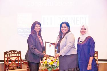 Kshanika Ratnayake, CEO Great Place to Work presents H Connect's GPTW certificate to Ayesha Ediriwickrema, Senior Manager Human Resources and Administration and Fazla Faris, Junior Executive, Human Resources