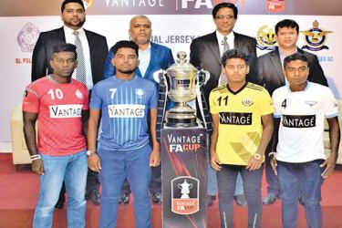 The team captains and the officials pose for a picture with the FA Cup at a media briefing held at Football House. Front row: (from left) W.K. Amith Chanaka (Police), Lahiru Tharaka (Blue Star), Indreewa Udara (Saunders) and Dimuthu Gunasinghe (Blue Eagles). Back row: (from left) ) Mohamed Musfir – Marketing Manager, Ebony Holdings (Pvt) Ltd, Razeen Raheem – Managing Director, Ebony Holdings (Pvt) Ltd, Anura De Silva – President of Football Federation of Sri Lanka and Jaswar Umar – Secretary of Football Fed