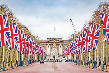 Union flags have been erected along The Mall in central London, with Buckingham Palace framed in the distance to celebrate Brexit.