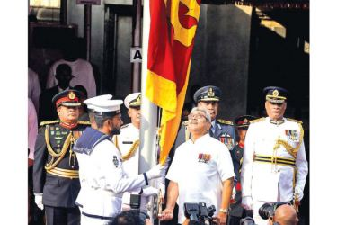 President Gotabaya Rajapaksa flanked by the three Tri-Forces Commanders and the acting IGP hoisting the national flag at the 72nd Independence Day celebrations held at the Independence Square,Colombo 7 yesterday.
