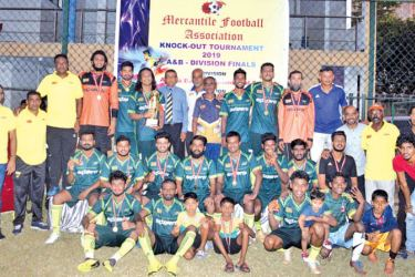 'A' Division champions, Expolanka SC team with the trophy. (Pictures by Sudath Nishantha)