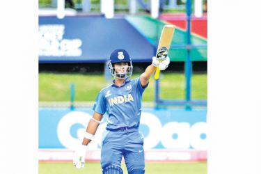 India's batsman Yashasvi Jaiswal celebrates after scoring a century during the ICC Under-19 World Cup cricket semi-final between India and Pakistan at the Senwes Park, in Potchefstroom, on February 4, 2020.