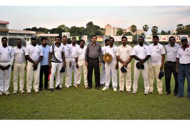 The winning State Services CA team posing for a photograph with the chief guest. PICTURES BY HERBERT PERERA