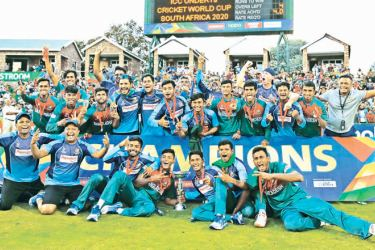 The Bangladesh cricket team pose for a group photograph after winning the ICC Under-19 World Cup cricket finals between India and Bangladesh at the Senwes Park, in Potchefstroom, on February 9. AFP