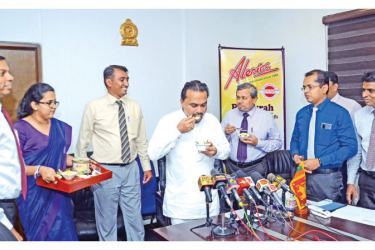 Minister Wimal Weerawansa tasting the new Palmyrah Ice Cream looked on by Chairman, PDB, Krishantha Pathiraja and Managing Director/CEO, Alerics, Dhanuka Liyanagamage and Chairman, CWE, Nushad Perera. Picture by Wimal Karunatillike