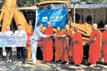 Qian Hao Jun, the Project Manager of Implementation of Gampaha, Attanagalla, Minuwangoda integrated water supply scheme hands over the keys of the equipment to the Gangarama temple