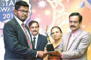 Norwood Tea Factory official receives the award