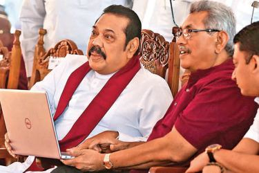 NEW CARPET ROADS: The National programme to develop 100,000 kilometers of rural roads was launched yesterday with President Gotabaya Rajapaksa and Prime Minister Mahinda Rajapaksa as chief guests.The project was launched under the policy manifesto 'Rata Hadana Saubhagyaye Dekma'. The development work of a 52 km-stretch of Peradeniya - Rikillagaskada road via Galaha and Delthota commenced yesterday. Picture by Nissanka de Silva.